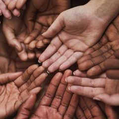 Shot of a group of hands held cupped out together